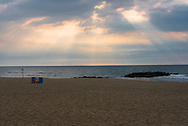 Morning sun breaks through the clouds in Asbury Park
