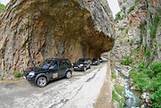 Mountainous road the cliff overhangs over the road. Photographed in Northern Greece