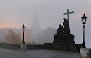 Lamentation of Christ statue, 1858 by Emanuel Max, on the Charles Bridge or Karluv most, built 1357 - 15th century, over the Vltava river, Prague, Czech Republic. The statue was a commission from the Old Town's public authorities, and depicts Mary Magdalene and the Virgin Mary mourning the dead Christ, with a large crucifix. The historic centre of Prague was declared a UNESCO World Heritage Site in 1992. Picture by Manuel Cohen
