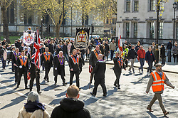 Orange men of the Orange order march through Parliament Square before marching  along Whitehall to lay wreaths at the Cenotaph London.<br /> <br /> Richard Hancox | EEm 13042019