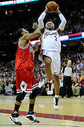 Apr 19, 2010; Cleveland, OH, USA; Cleveland Cavaliers guard Mo Williams (2) shoots over Chicago Bulls guard Derrick Rose (1) during the second period in game two in the first round of the 2010 NBA playoffs at Quicken Loans Arena. Mandatory Credit: Jason Miller-US PRESSWIRE