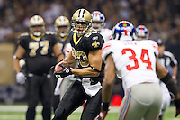 28 November 2011: Tight end (80) Jimmy Graham of the New Orleans Saints catches a pass and runs for a first down against the New York Giants during the first half of the Saints 49-24 victory over the Giants at the Mercedes-Benz Superdome in New Orleans, LA.