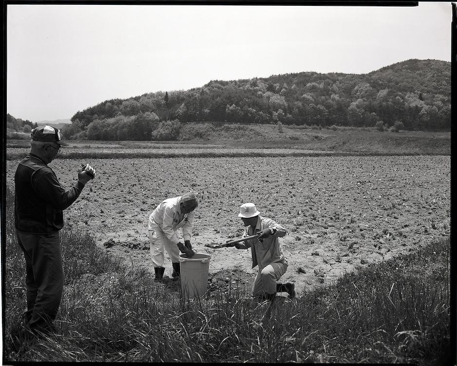Taking samples of Radioactive soil form  Katsuzo Shoiji's rice field Levels of more then 10  micro severts are still present more than 60 days after the  march 15 explosions and fire at  Daiichi Nuclear powerplants 40km away<br /> <br />  Katsuzo Shoji's (75) family has worked   this land for  more then 6 generations Like the rest of the town's population  he is being forced to evacuate most likely to an apartment 20km away.  uncertain when he will be able to return he has been able to rent some land to continue his work  outside of the  heavily  contaminated village.  the  Fukushima Daiichi nuclear power plant, about 40km away.  Outside the 20km government exclusion zone, the village&rsquo;s mountainous topography  funneled radiation spewing from its crippled reactors trapping it there, poisoning crops , water and livestock.  he has  been told  he must  destroy his crops and  his six prized  Iitate beef cows must be killed.
