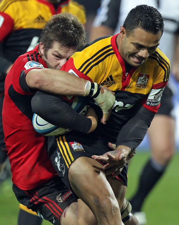 Crusaders' Richie McCaw tackles Chiefs' Lelia Masaga in a Super Rugby match, Waikato Stadium, Hamilton, New Zealand, Friday, July 06, 2012.  Credit:SNPA / David Rowland