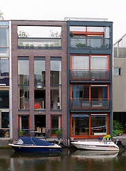 Modern architecture of new houses beside canal on Borneo Island new property development in Amsterdam Netherlands