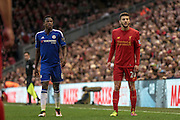 Adam Lallana (Liverpool) and Baba Rahman (Chelsea) wait for the throw in to be taken during the Barclays Premier League match between Liverpool and Chelsea at Anfield, Liverpool, England on 11 May 2016. Photo by Mark P Doherty.
