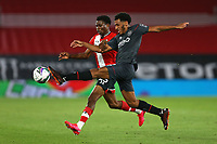 Football - 2020 / 2021 EFL Cup - Round 2 -Southampton vs. Brentford <br /> <br /> Dominic Thompson of Brentford clears from Southampton's Nathan Tella during the EFL cup tie at St Mary's Stadium Southampton<br /> <br /> COLORSPORT/SHAUN BOGGUST