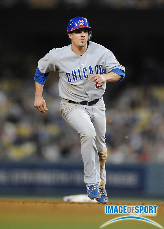 June 2, 2008; Los Angeles, CA, USA; Chicago Cubs shorststop Ryan Theriot (2) rounds third base to score the winning run in the ninth inning of 5- 4 victory over the Los Angeles Dodgers at Dodger Stadium.