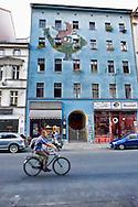 Berlino 14  Settembre 2013<br /> A uomo in bicicletta per una  via del quartiere Kreuzberg<br /> A man on a bicycle to a street in the Kreuzberg district
