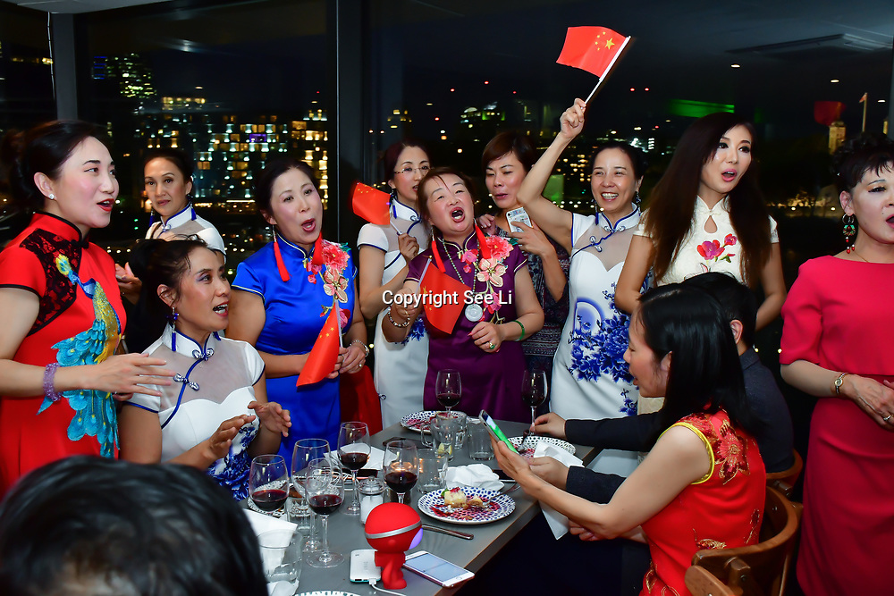 "China Britain Business women association hosts The 2nd China Britain Fashion Festival ""Qipao"" The mainland Chinese and oversea born Chinese singing together (我和我的祖国)Me and my country. To celebration of Great China 70th China National Day 2019. A ""Chinese Qipao"" Flash mob. The Chinese in 28 counties and cities across Britain participate in the thousands of cheongsams and end in London today on the 28 September 2019, UK."