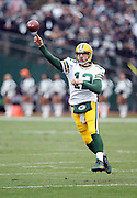 Green Bay Packers quarterback Aaron Rodgers (12) jumps and throws a first quarter pass during the 2015 week 15 regular season NFL football game against the Oakland Raiders on Sunday, Dec. 20, 2015 in Oakland, Calif. The Packers won the game 30-20. (©Paul Anthony Spinelli)