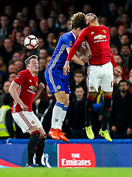 Chris Smalling of Manchester United heads clear from David Luiz of Chelsea - Rogan Thomson/JMP - 13/03/2017 - FOOTBALL - Stamford Bridge - London, England - Chelsea v Manchester United - FA Cup Quarter Final..