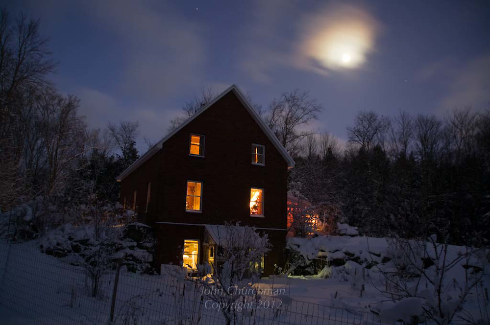moon shine, VT country house alight in VT winter