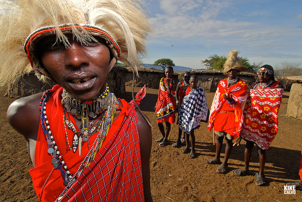 Masais dancing and performing their traditional songs. Masai Mara tribe around the Masai Mara National Park. Kenya. East Africa.