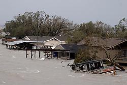 24 Sept, 2005. Cameron, Louisiana. Hurricane Rita aftermath. <br /> Route 27, Louisiana where the storm hit hardest on the Louisiana/Texas border. The back edge of Rita floods houses north of Cameron, Louisiana.<br /> Photo; ©Charlie Varley/varleypix.com