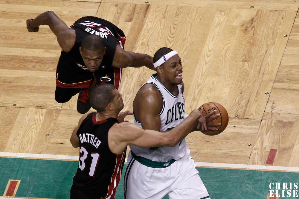 01 June 2012: Boston Celtics small forward Paul Pierce (34) drives past Miami Heat small forward Shane Battier (31) and Miami Heat small forward James Jones (22) during the Boston Celtics 101-91 victory over the Miami Heat, in Game 3 of the Eastern Conference Finals playoff series, at the TD Banknorth Garden, Boston, Massachusetts, USA.