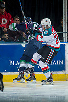 KELOWNA, CANADA - APRIL 30: Turner Ottenbreit #4 of the Seattle Thunderbirds is checked by Kyle Topping #24 of the Kelowna Rockets on April 30, 2017 at Prospera Place in Kelowna, British Columbia, Canada.  (Photo by Marissa Baecker/Shoot the Breeze)  *** Local Caption ***