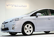 Toyota Motor Corp.'s third generation Prius hybrid car is driven onstage by company vice-president Akio Toyoda during an unveiling of the vehicle at the automaker's showroom  was in Tokyo, Japan on 18 May 2009.