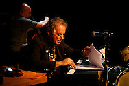 Poet, musician, composer and member of the Beat Generation David Amram performs with a jazz band reading poetry and performing music at the Bowery Poetry Club during the 2007 Howl Festival in New York City.