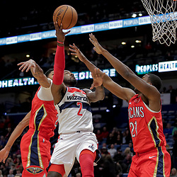 Nov 28, 2018; New Orleans, LA, USA; Washington Wizards guard John Wall (2) shoots between New Orleans Pelicans forward Anthony Davis (23) and forward Darius Miller (21) during the first quarter at the Smoothie King Center. Mandatory Credit: Derick E. Hingle-USA TODAY Sports
