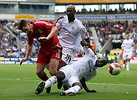 Photo: Paul Thomas.<br /> Bolton Wanderers v Liverpool. The Barclays Premiership. 30/09/2006.<br /> <br /> Stephen Finnan, of Liverpool is fouled by Nicolas Anelka (C) and Abdoulaye Faye (R).