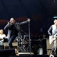 Picture By: Drew Farrell / Retna Pictures .Picture shows : - Larry Mullen Jr, Bono and Adam Claytonperforming during The U2 360° Tour  at Hampden Park, Glasgow, Scotland. Tuesday August 18th, 2009 . * Non-Exclusive World Rights * .*Unbylined uses will incur an additional discretionary fee!*....