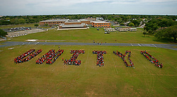 Apr. 28, 2010 - St. Petersburg, Florida, U.S. - Students and the entire staff at John Hopkins Middle School spell out 'UNITY' on their football field to show their commitment to unify the school and make it a better place during a celebration of 'Unity Day' at John Hopkins Middle in conjunction with Community of Tampa Bay. Estevez had the children break off in groups and make lists of behaviors that unite and that don't, with the focus to give the kids power in leading the school in curbing the in fighting they have been dealing with.   Language arts teacher R. Serne said that 44 children were chosen to be part of the session and they were chosen specifically from different backgrounds and groups in the school.  This is the first step in a long-range plan to unite neighborhoods and schools and to build an infrastructure that promotes civility and cooperation. Teachers and students have undertaken a series of activities to 'put unity back in the community' including a quilting project capturing the essence of specified neighborhoods, a study of historical facts of these neighborhoods, an essay contest, and recognition of literary works that include poetry, rap, song and dance. The culminating activity will be the human formation of the word 'UNITY' on the school field. Neighborhoods and businesses that are part of the John Hopkins family have been invited to attend. (Credit Image: © (Kathleen Flynn/Mike Medley of St. Petersburg Fire and Rescue/Kathleen Flynn/Tampa Bay Times/ZUMApress.com)