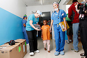 No. 74, Sidonie Haritiana, UCL, unilateral Cleft lip, female, 7 years old, <br /> before, walks form child life to the OR with Child life specialist Joy Daugherty and anesthesiologist Denise Chan.<br /> <br /> Operation Smile South Africa<br /> Operation Smile Mission to Hospital Joseph Ravoanangy Andrianavalona,<br /> Antananarivo, Madagascar. September 17th - 29th 2011<br /> <br /> &copy; Operation Smile Photo / Zute &amp; Demelza Lightfoot<br /> www.lightfootphoto.com