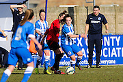 Brighton first team debutant Phoebe Leitch battles during the FA Women's Sussex Challenge Cup semi-final match between Brighton Ladies and Hassocks Ladies FC at Culver Road, Lancing, United Kingdom on 15 February 2015. Photo by Geoff Penn.