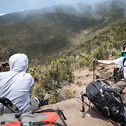 Hikers take a break in the heath zone on Mt Kilimanjaro's Lemosho Trail at about 10,000 feet.