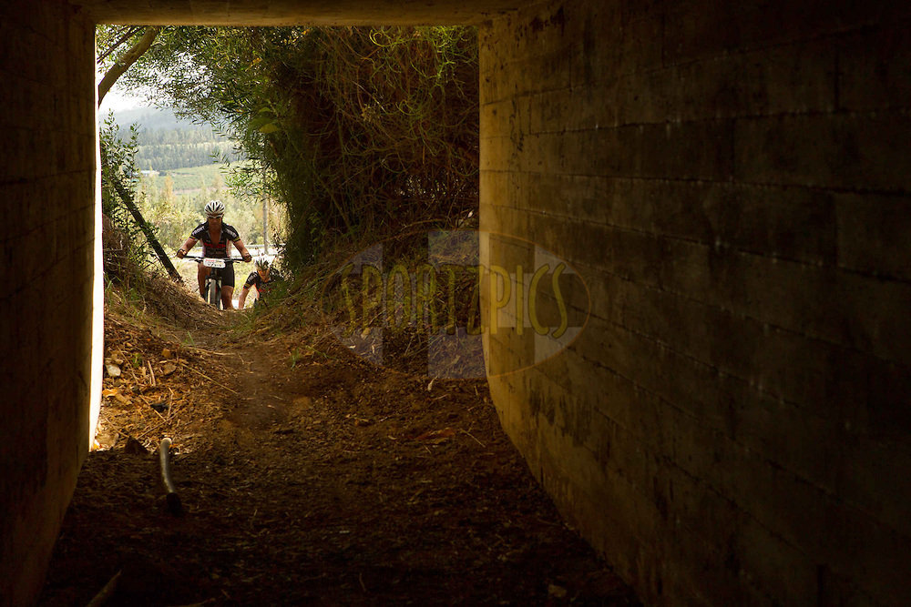 Wesley Botha and Andrew Steytler approach a tunnel during stage 6 of the 2013 Absa Cape Epic Mountain Bike stage race from Wellington to Stellenbosch, South Africa on the 23 March 2013..Photo by Greg Beadle/Cape Epic/SPORTZPICS