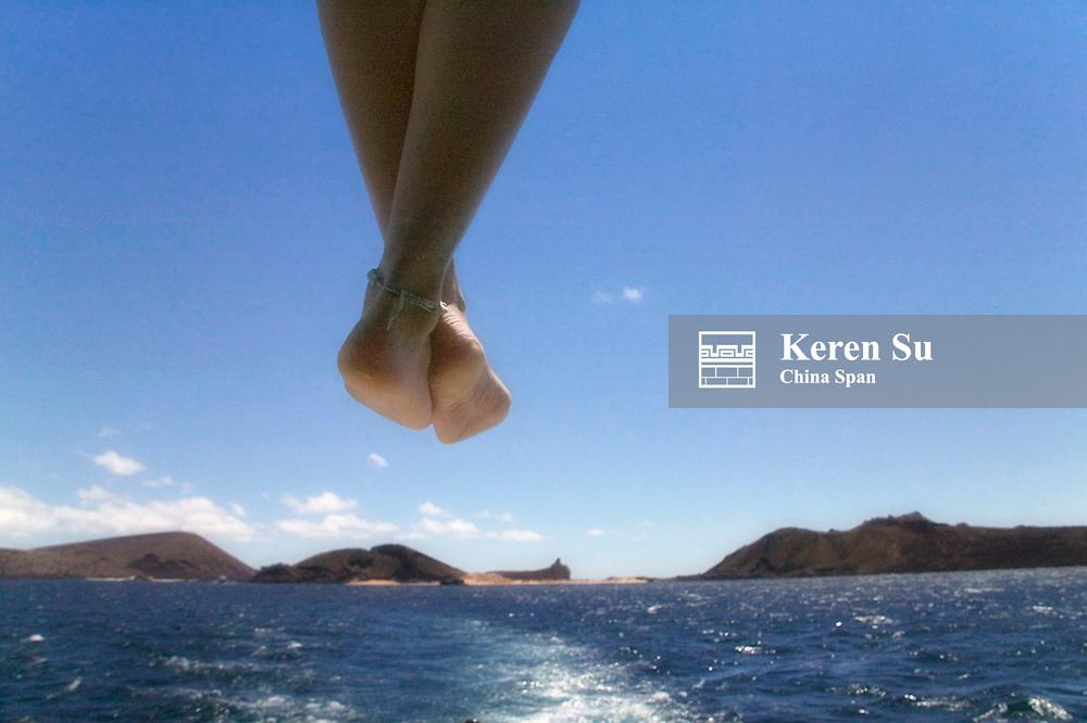 Traveler's legs dangling from boat, Galapagos Islands, Ecuador