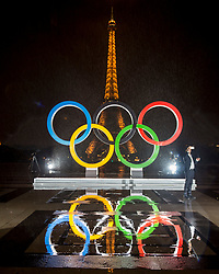 &copy; Licensed to London News Pictures13/09/2017 Paris, France.  <br /> <br /> 13 September 2017, Trocadero Paris (France): A journalist cannot resist a mandatory selfie in front of the newly unveiled giant Olympic Rings. The IOC (International Olympic Committee) formally announce the host of the 2024 Summer Games awarding Paris the prize. Photo credit: Guilhem Baker/LNP