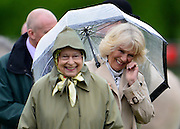 © Licensed to London News Pictures. 10/05/2013. Windsor, UK  Camilla, Duchess of Cornwall greets HRH Queen Elizabeth II laugh whilst they watche horses in the show. The Royal Windsor Horse Show, set in the grounds of Windsor Castle. Established in 1943, this year will see the Show celebrate its 70th anniversary. Photo credit : Stephen Simpson/LNP