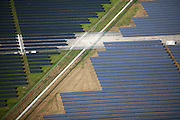 Solar panels on old airbase outside of Oldenburg. Note former runway and also security fence dividing two political jurisdictions.