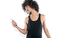 Happy young man listening to mp3 player over white background