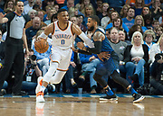 OKLAHOMA CITY, OK - FEBRUARY 26: Oklahoma City Thunder Guard Russell Westbrook (0) making a move towards the basket while Orlando Magic Guard D.J. Augustin (14) plays defense at Chesapeake Energy Arena Oklahoma City, OK (Photo by Torrey Purvey/Icon Sportswire)
