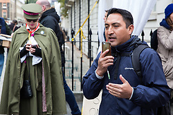 London, UK. 30th October, 2018. Henry Chango-Lopez, President of the Independent Workers of Great Britain (IWGB) trade union addresses members and supporters after a march with other precarious workers from the offices of Transport for London to the University of London via the Court of Appeal in support of Uber drivers who are seeking employment rights. The Court of Appeal will today hear an appeal by Uber against a ruling that its drivers are employees rather than self-employed workers.