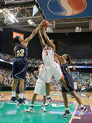 Georgia Tech forward Alex Montgomery (22) rejects a shot by Virginia guard Paulisha Kellum (3).  The #4 seed/#25 ranked Virginia Cavaliers women's basketball team defated the #5 seed Georgia Tech Yellow Jackets 52-43 in the quarterfinals of the 2008 ACC Women's Basketball Tournament at the Greensboro Coliseum in Greensboro, NC on March 7, 2008.