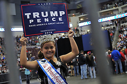 Littler Miss PA East Coast USA Alexis Martz, 9, holds up a sign in support of the Republican ticket at a rally at the Giant Center in Hershey, in Central Pennsylvania, on Fri. Nov. 4, 2016
