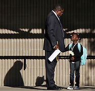 Chorley Elementary School principal Frederick Griffin talks to a student on the first day of school in the Middletown School District on Tuesday, Sept. 7, 2010.