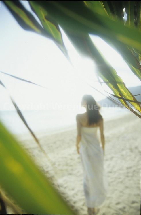 WALKING ON THE BEACH, KHO PHI PHI ISLAND, THAILAND