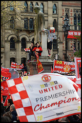 Manchester United Fans wait for Manchester United players to turn up in Albert Square, Manchester,  Manchester United celebrate winning their 20th league title winning the Premier League, Monday May 13, 2013. Photo by: Andrew Parsons / i-Images