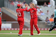 Lancashire Thunders Danielle Hazell (Captain) second wicket congratulated by Lancashire Thunders Nicole Bolton during the Women's Cricket Super League match between Lancashire Thunder and Surrey Stars at the Emirates, Old Trafford, Manchester, United Kingdom on 7 August 2018.