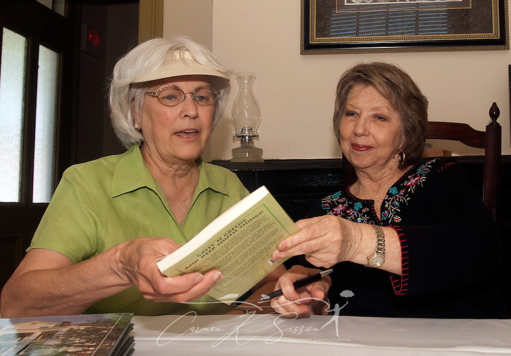 """Local author Sylvia Higginbotham (right) signs her book, """"Grits 'n Greens and Deep South Things"""" for a fan during a book signing at the Tennessee Williams Welcome Center in Columbus, Miss. April 17, 2010. (Photo by Carmen K. Sisson/Cloudybright)"""