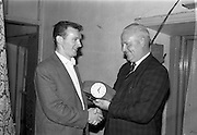 30/7/1964<br /> 7/30/1964<br /> 30 July 1964<br /> <br /> Presentation of the Smithwicks Clock, Presenting the clock on the Left is Mr. Charles Downes representative from Smithwicks to Mr. John Blake Captain of the Cuckoo's Nest art team Who was receiving the award on behalf of the Individual winner Mr. Christy Mullally