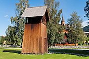 "Bell tower. Heddal stave church is Norway's largest stave church. This triple nave stave church, which some call ""a Gothic cathedral in wood,"" was built in the early 13th century and restored in 1849-1851 and the 1950s. Heddal stavkirke is in Notodden municipality, Telemark County, Norway."