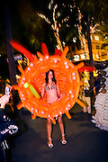 Balloon costume by artist Jason Hackenwerth, worn by a model in bikini and heels on Miami Beach's Lincoln Road, during Art Basel Miami Beach 2006.