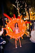 Balloon costume by artist Jason Hackenwerth, worn by a model in bikini and heels on Miami Beach's Lincoln Road, during Art Basel Miami Beach 2006.