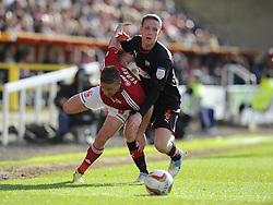 Swindon Town's Simon Ferry battles for the ball with Brentford's Adam Forshaw - Photo mandatory by-line: Joe Meredith/JMP - Tel: Mobile: 07966 386802 04/05/2013 - SPORT - FOOTBALL - County Ground - Swindon - Swindon Town v Brentford - Npower League one Play Off